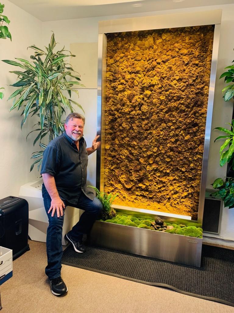 1. Jim Mumford with the Verdure living moss wall
